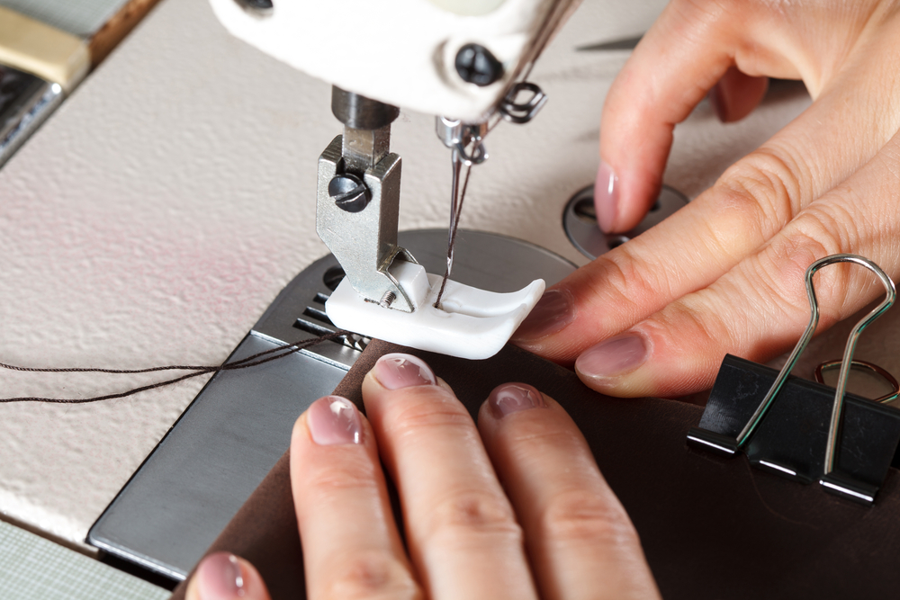 Sewing machine with womans hands